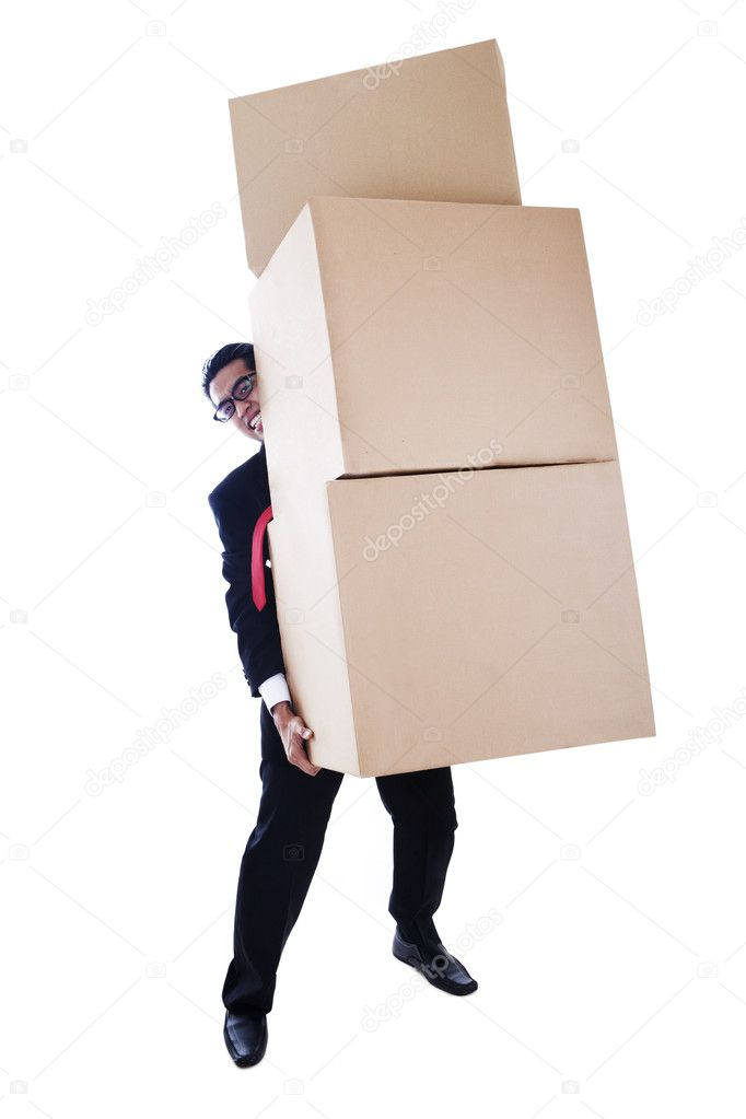 A businessman carrying heavy boxes shot in studio isolated on white background — Stock Photo #9231290