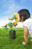 Toddler with sunflower — Stock Photo