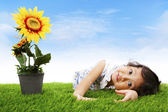 Cute girl with sunflower — Stock Photo