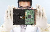 Scientist with computer harddisk — Stock Photo