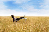 Businessman relaxing outdoor — Stock Photo