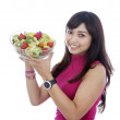 Smiling girl with salad — Stock Photo