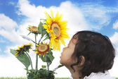 Cute girl with sunflowers — Stock Photo
