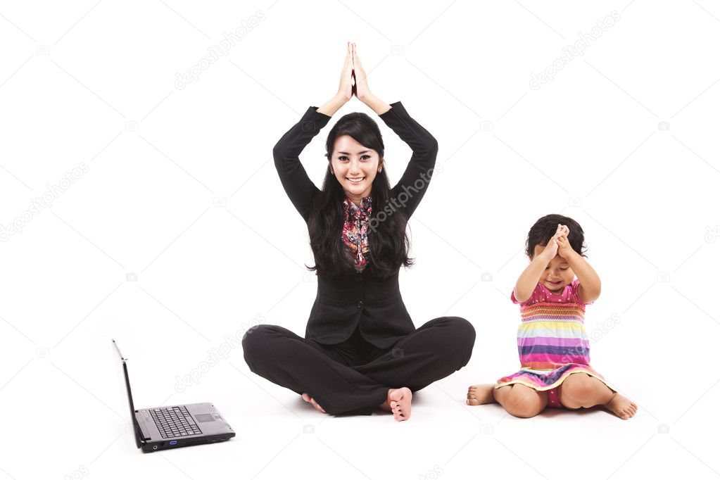 Businesswoman balancing work and play with her daughter — Stock Photo #9549162