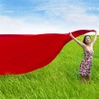 Carefree woman with red scarf on rice field — Stock Photo #9598958