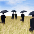 Businessmen with umbrella outdoor — Stock Photo