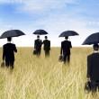 empresarios con el paraguas al aire libre — Foto de Stock