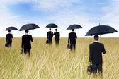 Businessmen with umbrella outdoor — Stock Photo