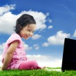 Stock Photo: Cute girl with laptop