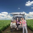 Happy Family on a road trip - Stock Photo