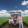 Stock Photo: Happy Family on road trip