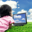 Girl with laptop computer outdoor — Stock Photo