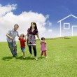 Young Asian Family with a drawn house on the field — Foto Stock