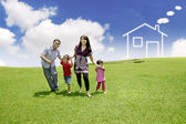 Young Asian Family with a drawn house on the field — Stock fotografie