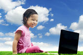 Happy girl with laptop — Stockfoto