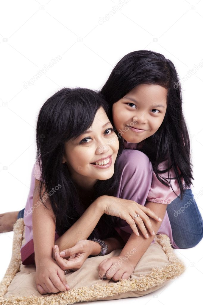 Portrait of happy asian mother and daughter. Shot in studio isolated on white — Stock Photo #9924753
