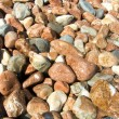 Pebble stones by the sea — Stock Photo