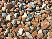 Pebble stones by the sea — Stock Photo