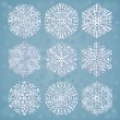 Snowflakes on blue background — Stock Vector #8037732