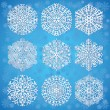 Snowflakes on blue background — Stock Vector #8037889