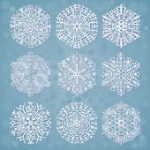 Płatki śniegu na niebieskim tle — Wektor stockowy