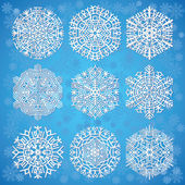 Snowflakes on blue background — Vecteur