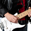 Guitarist playing on electric guitar isolated on white backgroun - Stock Photo