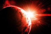 Red planet with a flash of sun — Stock Photo