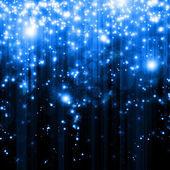 Estrellas descendiendo sobre fondo azul — Foto de Stock