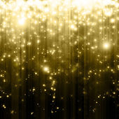 Stars descending on golden background — Stock Photo
