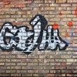 Brick wall with graffiti — Stock Photo