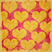 Grunge scratched hearts background — Stock Photo