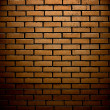 Brick wall with up spotlight — Stock Photo