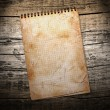 Old used notebook on wood background — Stock Photo