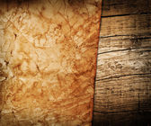 Vintage paper on old wood background — Stock Photo