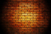 Brick wall with up spotlight — Zdjęcie stockowe