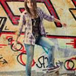 Pretty skater girl standing on skateboard — Stock Photo #10727892
