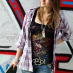Pretty skater girl holding skateboard — Stock Photo