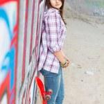 Pretty skater girl with skateboard — Stock Photo #10727909