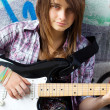 Closeup portrait of a young girl with guitar — Stock Photo
