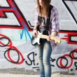 Closeup portrait of a happy young girl with guitar — Stock Photo