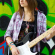 Stock Photo: Closeup portrait of a happy young girl with guitar