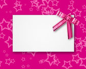 Blank postcard tied with a bow of pink ribbon — Stock Photo
