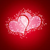 Twee gezamenlijke hart tegen rode backround — Stockfoto
