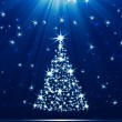 Christmas tree made of stars against blue background — Stock Photo #8155055