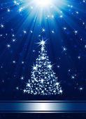 Christmas tree made of stars against blue background — Stock Photo