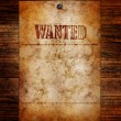 Vintage wanted poster on a wooden wall — Stock Photo #8240328