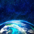 Blue earth in space with rising sun — Stock Photo #8273394
