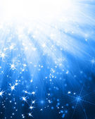 Blue background with rays and stars — Stock Photo