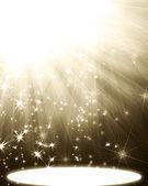Spotlight with rays and stars — Stock Photo